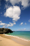 Beach Clouds. Tropical beach with a bright blue sky with large clouds Stock Images