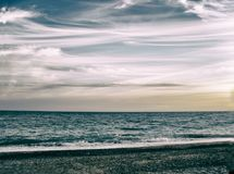Beach, over the sea hanging cloud royalty free stock photography