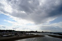 Beach and Clouds. The beach without tourists due to bad weather, Misano Adriatico, Italy stock photos
