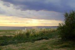 Beach. Clouds trees sun blue yellow green playa sol nubes tormenta stock photos