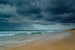 Beach and cloudy sky. Beach with stormy clouds in the sky Stock Image