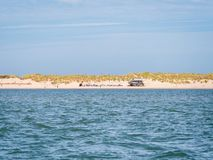 Beach club and dunes at coast of Ameland in Waddensea, Friesland royalty free stock photo