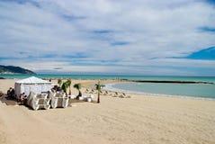 Beach and beach club in Mediterranean beach in Sitges, Spain during a cloudy day stock photo