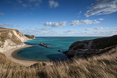 Beach coast of Dorset, England on summer day with blue sky. Lovely summer scene in Dorset England Royalty Free Stock Photography