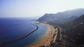 Beach on the coast near the blue sea. Beach on the coast of the blue sea. Near the high mountains stock video footage
