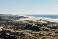 The beach and the coastline from a curve of Highway 101 off the coast of Oregon. View of the beach and the waterfront from a curve of Highway 101 off the coast stock images