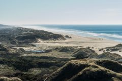 The beach and the coastline from a curve of Highway 101 off the coast of Oregon. View of the beach and the waterfront from a curve of Highway 101 off the coast royalty free stock image