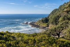 The beach and the coastline from a curve of Highway 101 off the coast of Oregon stock images