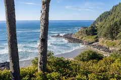 The beach and the coastline from a curve of Highway 101 off the coast of Oregon. View of the beach and the waterfront from a curve of Highway 101 off the coast royalty free stock photo