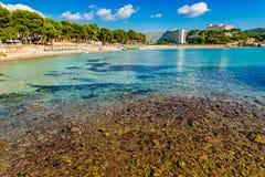Summer holiday at the beach in Paguera on Majorca Spain. Beach coastline of Platja de Tora in Paguera on Majorca Spain, Mediterranean Sea, Balearic Islands Stock Photography