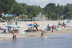 AT THE BEACH - COBOURG, ONTARIO. August 27, 2011 - A peaceful sunny day at Cobourg Beach in Central Ontario contrasts sharply with circumstances in the Eastern royalty free stock image