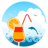 Beach cocktail. Cocktail on the beach, waves and fish Stock Photo