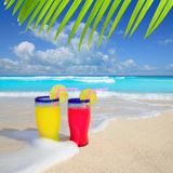 Beach cocktails yellow red wave foam tropical sea Stock Photo