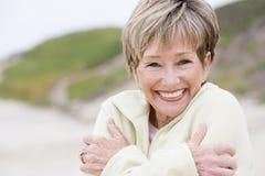 beach cold smiling woman Arkivbild
