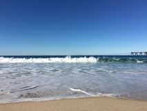 Beach. Cold beach water and wave seascape Royalty Free Stock Images