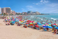 Beach with colorful umbrellas in Valencia. Royalty Free Stock Photography