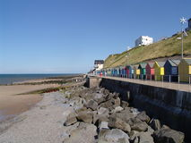 Colourful houses on the beach in a small English town, UK. Colourful buildings at the seafront Stock Photo