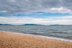 The beach with coming rainy storm cloud Stock Photography
