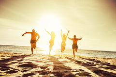 Beach concept group four friends Royalty Free Stock Photo