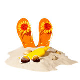 Beach concept with pile of sand. Beach items on a sunny pile of sand Royalty Free Stock Photo
