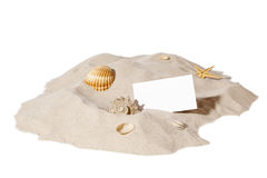 Beach concept with pile of sand and a blank card. Beach concept with seashell ,starfish and a blank card with copy-space.Focus on card Stock Photo