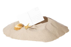 Beach concept with postcard. Beach concept with seashell ,starfish and a blank card with copy-space.Focus on card Stock Photography