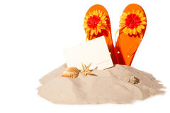 Beach concept with postcard and flip-flops Royalty Free Stock Image