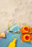 Beach concept with towel. Beach items on a towel with copy-space Stock Photo