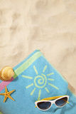 Beach concept with towel and sunglasses. Beach items on a towel with copy-space Stock Photography