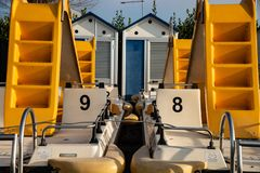 Pedal boats and sea cabins on the beach of Lake Garda, Italy. royalty free stock image
