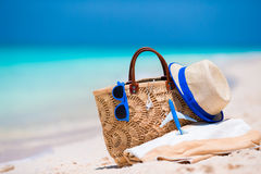 Beach consept - straw bag, hat, sunglasses and towel on white beach Royalty Free Stock Image