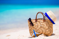 Beach consept - straw bag, hat, sunglasses and towel on white beach Stock Photo