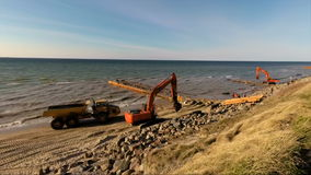 Beach with construction work to shore safe from flooding and sand erosion in storm stock footage