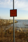 Beach Contamination. A warning sign on a beach, warning of oil contamination Stock Image
