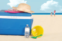 Beach cooler with hat and bottle water Stock Photography