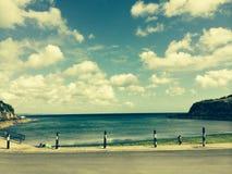 Beach in cornwall. Cliffs on beach in cornwall summer sunshine stock photography