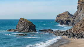 Beach in Cornwall, England. A rural rocky beach located in amongst of the cliffs of Cornwall, England Stock Photos