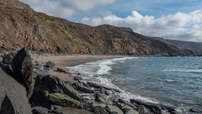 Beach in Cornwall, England. A rural rocky beach located in amongst of the cliffs of Cornwall, England Royalty Free Stock Photo