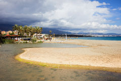 Beach on Costa del Sol. Costa del Sol in Spain, sandy beach located between Marbella and Puerto Banus, waters of Green River (Spanish: Rio Verde) and royalty free stock photography