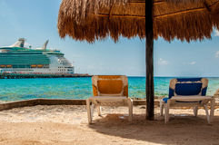 Beach in Costa Maya. Relaxing seats in costa maya with cruise ship Royalty Free Stock Image