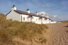 Beach Cottages. These pretty whitewashed beach cottages where photographed in North Wales, UK Stock Images