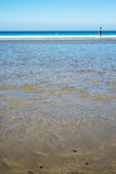 Beach in county kerry ireland with wading woman Royalty Free Stock Image