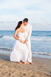 Beach couple Stock Images