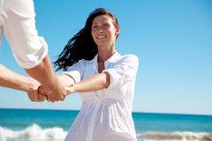 Beach couple. Playful dancing beach couple holding eachother stock photography