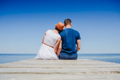 Beach couple enjoying fun romantic vacation holiday. At the beach Stock Image