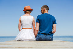 Beach couple enjoying holiday. Young couple enjoying fun romantic vacation holiday at the beach royalty free stock images