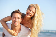 Beach couple fun - lovers on romantic travel Stock Images