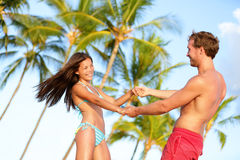 Beach couple fun on vacation dancing playful stock image