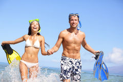 Beach couple fun in water laughing snorkeling Royalty Free Stock Photo