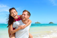 Beach couple having fun laughing on Hawaii holiday Stock Image
